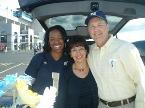 me, Lilia Ramirez, and her husband cheering on Navy 2012