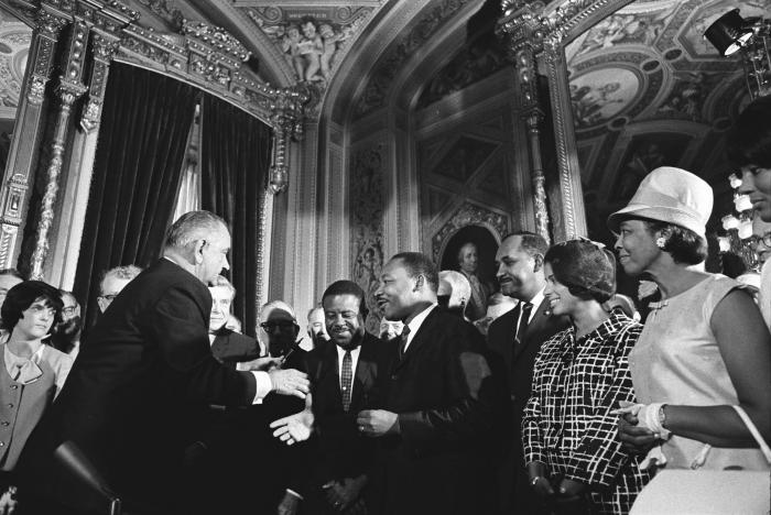 President Lyndon B. Johnson and Martin Luther King, Jr. at the signing of the Voting Rights Act of 1965